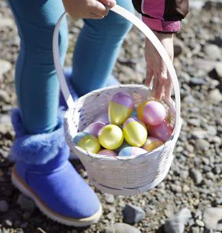 The sitting eggs on Commons Beach were quickly picked up and placed in Easter baskets by children.