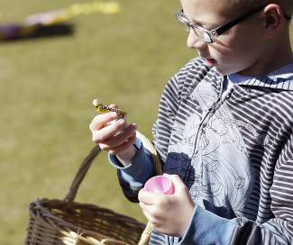Children found small pieces of candy inside the plastic Easter eggs they collected Saturday morning at Commons Beach.