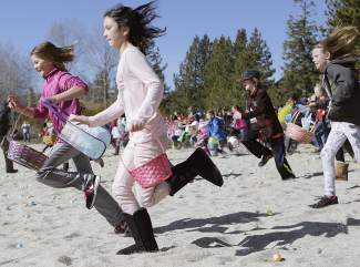 Starting at 10 a.m., the children were allowed to collect the waiting eggs, leading to a mad dash.