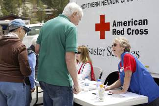 Incline Village resident Jim O'Conner registers with the American Red Cross Northern Nevada Chapter, which had a station at a mock emergency center in the lower parking lot of Diamond Peak on Saturday.