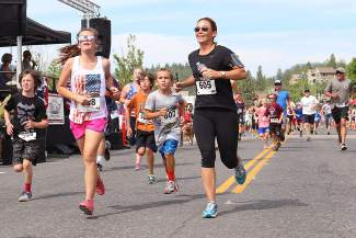 Fun run participants stream into the finish area in downtown Truckee on Saturday.