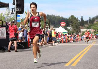 Eighteen-year-old Garrett Mack from Sacred Heart Prep in Atherton races to victory in the Firecracker Mile in a time of 4 minutes, 27 seconds.