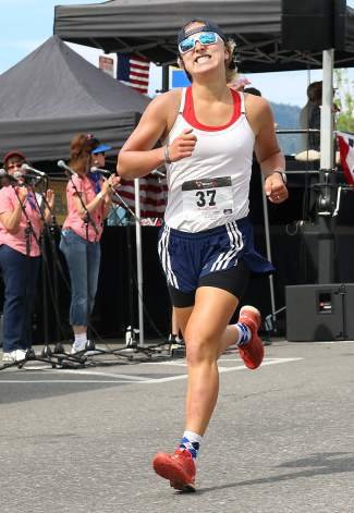 Truckee's Hannah Halvorsen races to a second-place finish among women in the Firecracker Mile on Saturday.