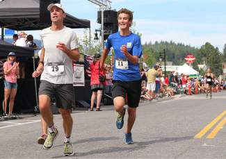 Max Roske (bib 11) tries his best to pass Jeff Schloss in Saturday's Firecracker Mile.