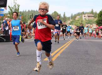 Eight-year-old Sven Halvorsen of Truckee digs for the finish line of the Firecracker Mile on Saturday.