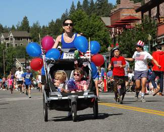 Truckee's Jessica Abrams, pushing two infants in a stroller, powers to the finish line.