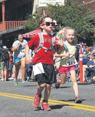Griffin Tuscano, left, and Adeline Purvance, both of Soda Springs, near the finish line.