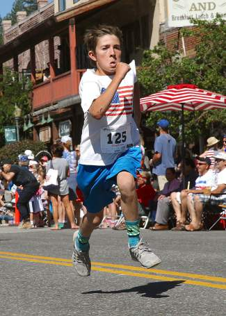 Griffin Roberts bounds to the finish line on Monday, July 4.