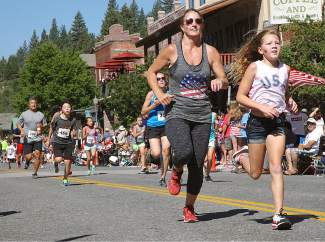 Firecracker Mile runners started in front of US Bank and ended in downtown Truckee.
