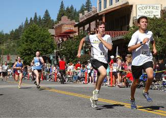 Jake Inclan, right, and Eric Mailes sprint to the finish.