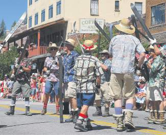 The Truckee River Drill Team, which has appeared in the Truckee Hometown parade for three decades, gives its founder Bill Palmer a send-off.