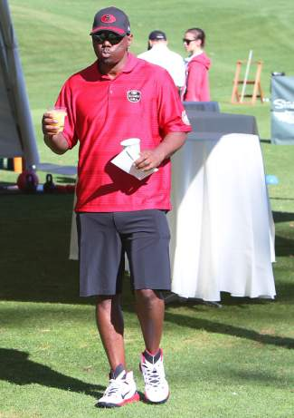 Former NFL running back Ricky Watters hydrates before Monday's fundraising tournament.