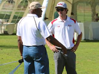 Pitching great Vida Blue talks to Truckee assistant football coach Robert Jones during Monday's Gene Upshaw Memorial Golf Classic. Truckee football players and coaches helped out at the fundraising tournament.