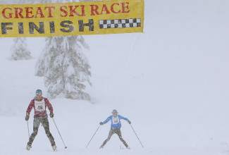 Genevieve Evans of Carnelian Bay, front, and JP Donovan of Incline Village cruise to the finish of the Great Ski Race in snowy conditions Sunday. They finished 42nd and 43rd, respectively.