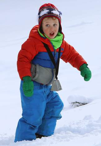 A young Great Ski Race fan comes prepared with a cowbell.