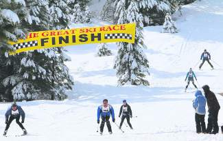 Participants tuck to the finish of the Great Ski Race on Sunday, March 6. Some 580 people registered for the 39th edition of the race, which featured variable conditions and weather ranging from blue skies to heavy snow along the 30-kilometer course.