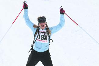 Sue Duerksen of Truckee raises her arms in triumph after covering 30 kilometers in the Great Ski Race.