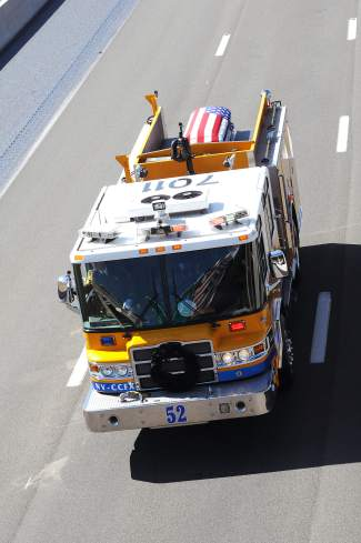 A firetruck carrying the casket of Carson City Sheriff's Deputy Carl Howell travels through Washoe Valley Thursday morning.