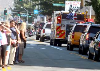 People line Carson Street in Downtown Carson City to pay respects to fallen Carson City Sheriff's Deputy Carl Howell.