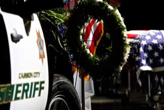 A Caron City Sherrif's vehicle is shown in the Reno Events Center as Deputy Carl Howell's casket lies in the background.