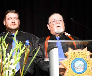 Carl Howell's brother and father, Cory and Kevin, share stories of the slain Deputy's life Thursday at the Reno Events Center.