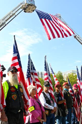 Patriot Guard members line the entrance way to the Reno Events Center while an American flag flies overhead at Deputy Carl Howell's service Thursday.