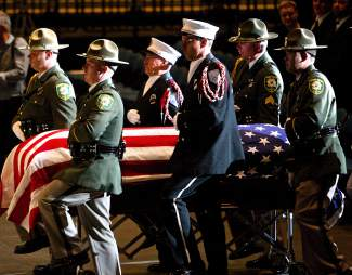 Honor Guard Officers carry fallen Deputy Carl Howell's casket on Aug. 20 into the Reno Events Center, where over 1000 people were in attendance.