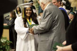 Incline High School graduate and Targe Award winner Juana Angel Serna accepts her diploma from board of trustee member John Mayer.