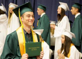 Incline High School graduate Owen Price shows off his diploma.