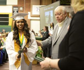 Incline High graduate Jhoselin Najar holds her diploma, which she accepted from board of trustee member John Mayer.