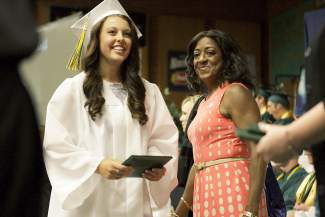 Incline High School graduate McKenna Hoff grins after accepting her diploma from board of trustee member Angie Taylor.