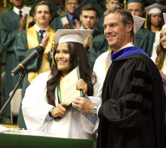 Incline High School graduate Juana Angel Serna accepts the Targe Award from site administrator Andrew Yoxsimer during the June 18, 2015, graduation ceremony.