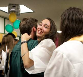 Taryn Baker-Hewitt hugs a fellow Incline High School graduate after the June 18 commencement ceremony.