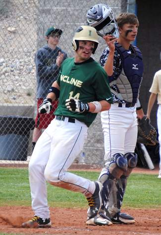 Owen Graffis scores a run in the Highlanders' 6-3 win over Yerington on Friday.