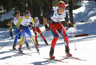 Shane Christian (bib 8) of Far West Nordic trails Karsten Hokanson (3) during Monday's Junior Nationals at Auburn Ski Club.