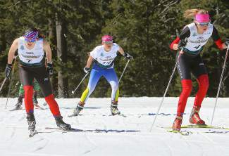 Lizzie Larkins, center, competes in a U18 sprint heat on Monday.