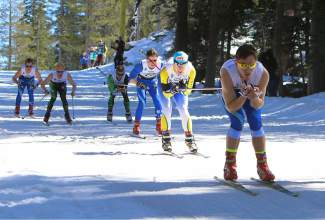 Far West Nordic's Dylan Syben skis down a hill in second place during a sprint heat on Monday.