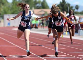 North Tahoe senior Allie Doyle anchors the girls 4 x 200 relay team to a narrow victory in the state championship meet.