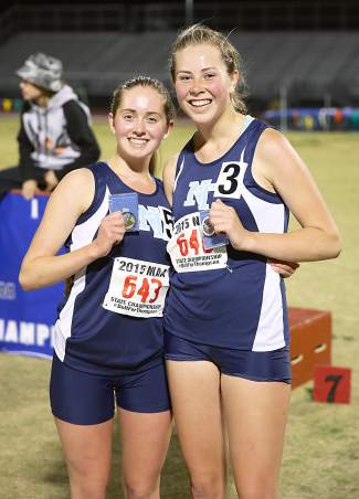 Tara Gallant, left, and Kaya Williams placed first and third, respectively, in the 3,200 in the state championship meet.