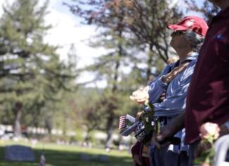 A woman places her hand over her heart as the American flag was raised at the beginning of Truckee's Memorial Day ceremony.