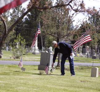 Several of those attending Truckee's Memorial Day ceremony laid flowers on veteran gravesites in Sierra Mountains Cemetery.