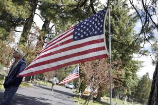 Many American flags were on display, lining paths and dotting the gravesites of buried veterans during Monday's Memorial Day service.
