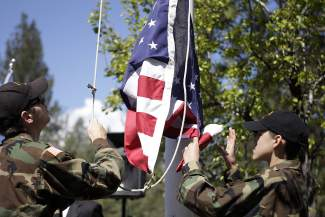 Members of the Civil Air Patrol Tahoe-Truckee Squadron raise the American Flag.