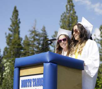 From left, Ingrid Roske and Kasey Foster present the senior speech at North Tahoe High School's graduation.