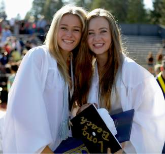 From left, Sarah Mowris and Annie Thompson pose together after North Tahoe High's graduation ceremony Thursday at Laker Stadium.