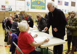GOP voters line up in the Incline Middle School gym Tuesday evening.