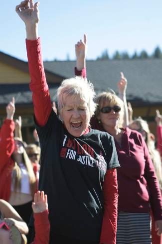 Truckee resident Ramona Wheeler points her index finger skyward in unison with others at the end of the dance.