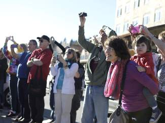"Onlookers take pictures and watch during Truckee/Tahoe community's performance of ""Break the Chain,"" the One Billion Rising flash mob."