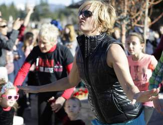 Tahoe Donner resident Courtney Murrell was among the roughly 100 community members taking part in Saturday's dance, which had gestures that called for violence against women and girls to stop.