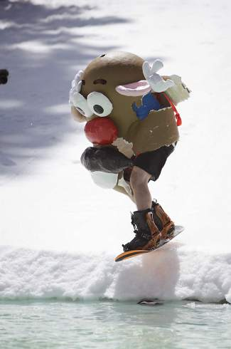 Several pond skimming participants dressed up such as this man as Mr. Potato Head. Other costumes included an ape, the abominable snowman, Superwoman, a Gaints player and a doctor.